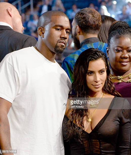 Kanye West and Kim Kardashian West pose during the 2016 MTV Video Music Awards at Madison Square Garden on August 28 2016 in New York City