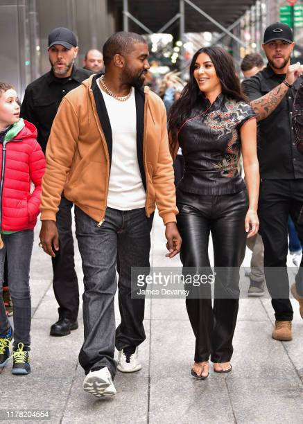 Kanye West and Kim Kardashian West walk along 57th Street on October 25 2019 in New York City