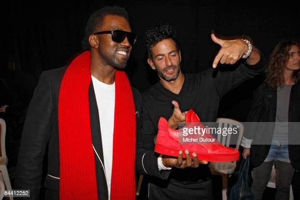 Kanye West and Marc Jacobs with the Louis Vuitton shoe designed by West backstage at the Louis Vuitton fashion show during Paris Fashion Week...
