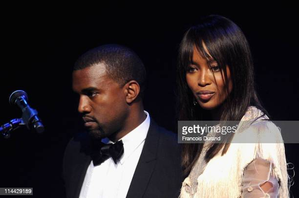 Kanye West and Naomi Campbell onstage at amfAR's Cinema Against AIDS Gala during the 64th Annual Cannes Film Festival at Hotel Du Cap on May 19, 2011...