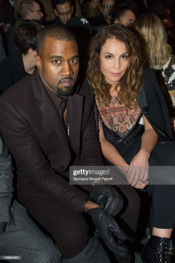 Kanye West (L) and Noomi Rapace attend the Givenchy Men Autumn / Winter 2013 show as part of Paris Fashion Week on January 18, 2013 in Paris, France.