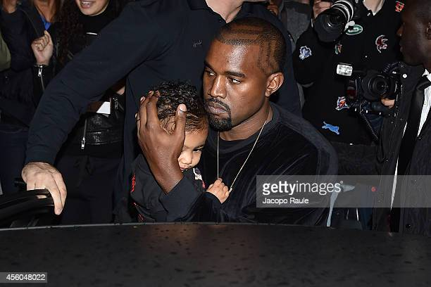 Kanye West and North West arrive at Balenciaga Show during Paris Fashion Week Womenswear SS 2015 on September 24 2014 in Paris France