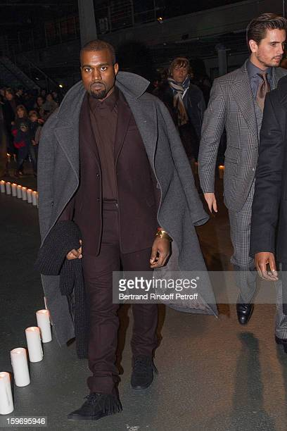 Kanye West and Scott Disick attend the Givenchy Men Autumn / Winter 2013 show as part of Paris Fashion Week on January 18 2013 in Paris France