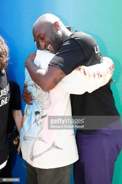 Kanye West and Stylist Virgil Abloh pose after the Louis Vuitton Menswear Spring/Summer 2019 show as part of Paris Fashion Week on June 21 2018 in...