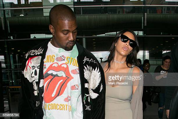 Kanye West and wife Kim Kardashian West arrive at CharlesdeGaulle airport on June 13 2016 in Paris France