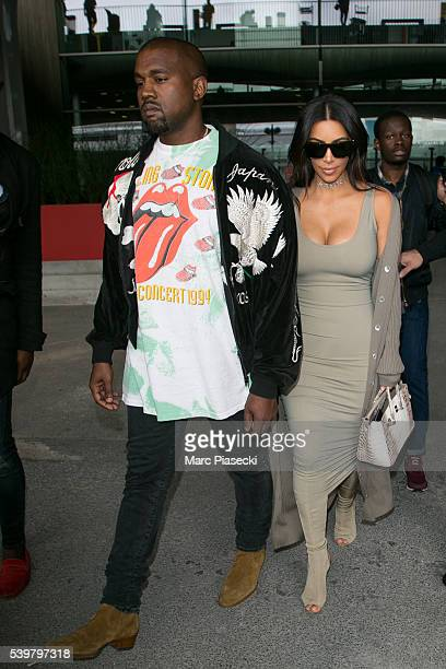 Kanye West and wife Kim Kardashian West arrive at ChrledeGaulle airport on June 13 2016 in Paris France