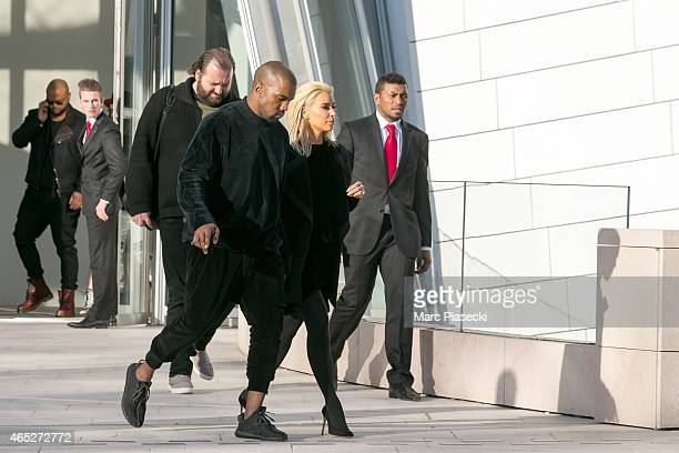 Kanye West and wife Kim Kardashian West leave the 'Louis Vuitton' Foundation on March 5 2015 in Paris France
