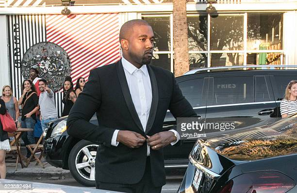 Kanye West attends David Grutman's and model Isabela Rangel wedding in Wynwood Wall on April 23 2016 in Miami Florida
