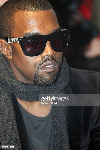 Kanye West attends the Cerruti fashion show during Paris Menswear Fashion Week Autumn/Winter 2010 at Palais de Tokyo on January 22 2010 in Paris...