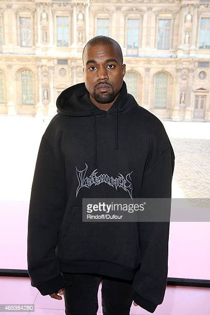 Kanye West attends the Christian Dior show as part of the Paris Fashion Week Womenswear Fall/Winter 2015/2016 at Cour Carree du Louvre on March 6...