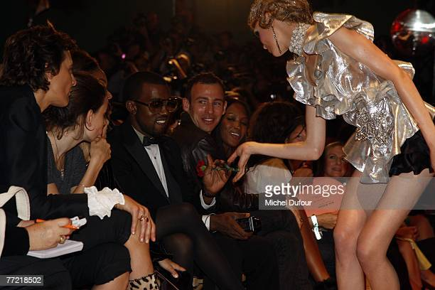 Kanye West attends the John Galliano fashion show, during the Spring/Summer 2008 ready-to-wear collection show at Stade Francais on October 6, 2007...