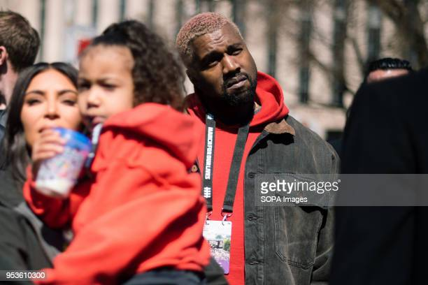 Kanye West attends the March For Our Lives in Washington DC with wife Kim Kardashian West and daughter North West