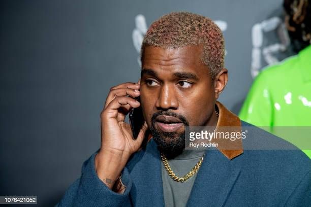 Kanye West attends the the Versace fall 2019 fashion show at the American Stock Exchange Building in lower Manhattan on December 02 2018 in New York...