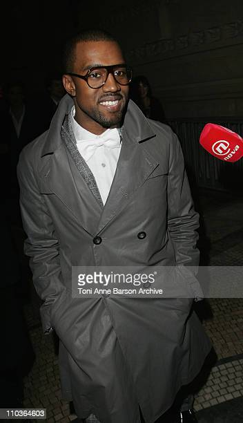 Kanye West attends the Yves Saint Laurent Fashion show during Paris Fashion Week FallWinter 20082009 at the Grand Palais on February 28 2008 in Paris...