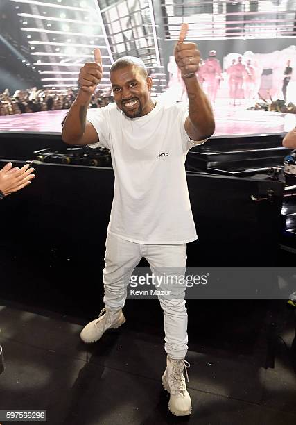 Kanye West gives a thumbs up during the 2016 MTV Video Music Awards at Madison Square Garden on August 28 2016 in New York City