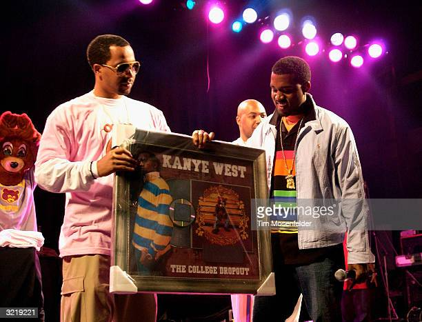 Kanye West is presented with his first platinum album His College Dropout release reached platinum in 8 weeks Event held at The Grand on April 3 2004...