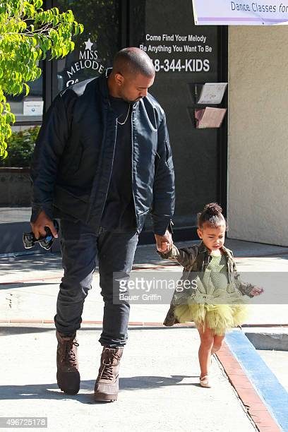 Kanye West is seen with his daughter North West on November 11 2015 in Los Angeles California
