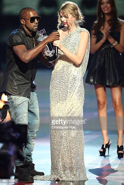 Kanye West jumps onstage after Taylor Swift won the 'Best Female Video' award the 2009 MTV Video Music Awards at Radio City Music Hall on September...