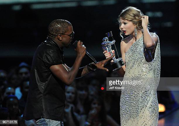 Kanye West jumps onstage as Taylor Swift accepts her award for the Best Female Video award during the 2009 MTV Video Music Awards at Radio City Music...