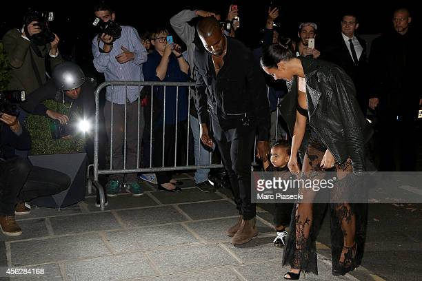 Kanye West Kim Kardashian and North west arrive at the 'Art District' apartments on September 28 2014 in Paris France