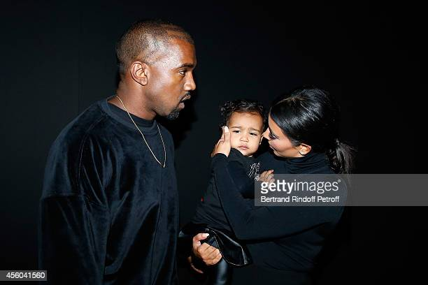 Kanye West Kim Kardashian and theis daughter North West attend the Balenciaga show as part of the Paris Fashion Week Womenswear Spring/Summer 2015 on...