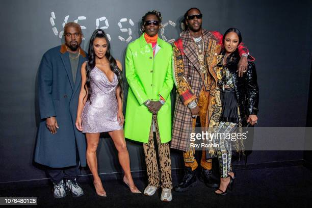 Kanye West Kim Kardashian West Young Thug 2 Chainz and Kesha Ward attend the the Versace fall 2019 fashion show at the American Stock Exchange...