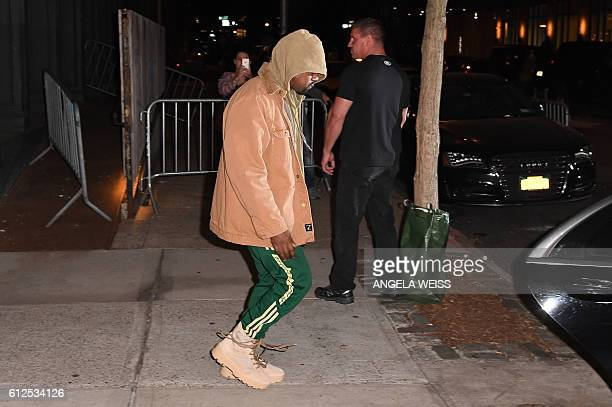 Kanye West leaves his apartment in New York on October 4 2016 Kim Kardashian freed herself and raised the alarm after being tied up and robbed at...