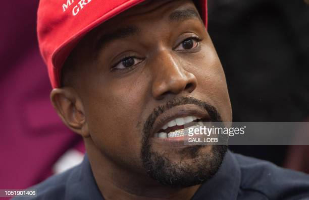 Kanye West meets with US President Donald Trump in the Oval Office of the White House in Washington DC October 11 2018