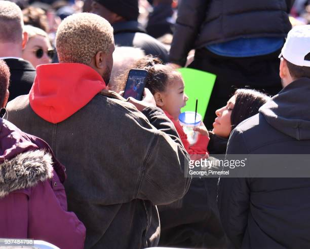 Kanye West North West and Kim Kardashian are seen in the crowd at March For Our Lives on March 24 2018 in Washington DC attends March For Our Lives...
