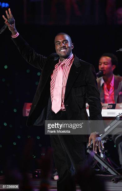 Kanye West performs at the 2004 MTV Video Music Awards at the American Airlines Arena August 29 2004 in Miami Florida