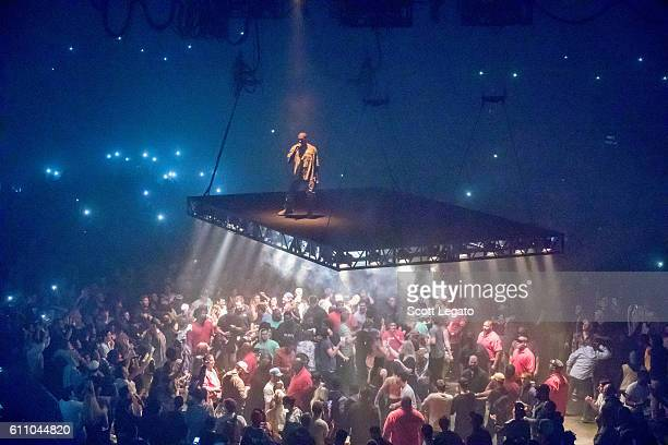 Kanye West performs during The Saint Pablo Tour at Joe Louis Arena on September 28 2016 in Detroit Michigan