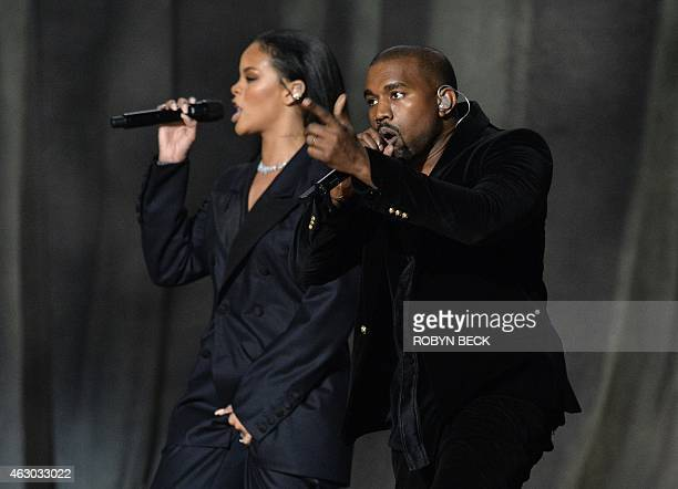Kanye West performs with Rihanna on stage at the 57th Annual Grammy Awards in Los Angeles February 8 2015 AFP PHOTO / ROBYN BECK