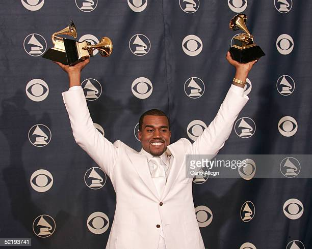 Kanye West poses backstage with his awards for Best Rap Album Best Rap Song and Best R B Song during the 47th Annual Grammy Awards at the Staples...