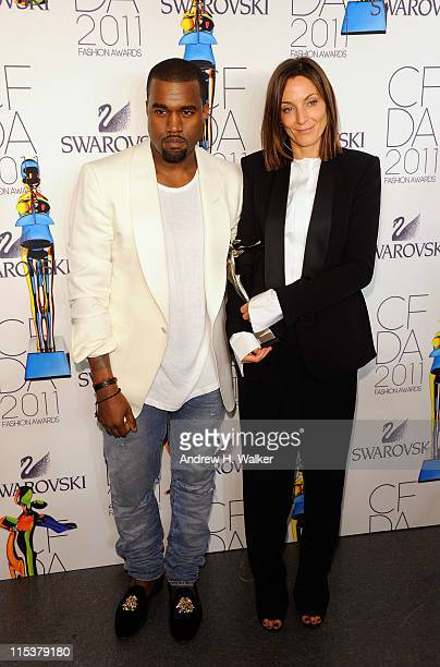 Kanye West poses backstage with International Award honoree Phoebe Philo at the 2011 CFDA Fashion Awards at Alice Tully Hall, Lincoln Center on June...