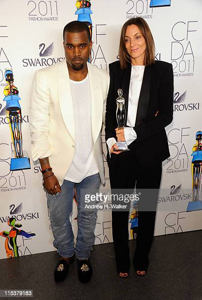 Kanye West poses backstage with International Award honoree Phoebe Philo at the 2011 CFDA Fashion Awards at Alice Tully Hall Lincoln Center on June 6...