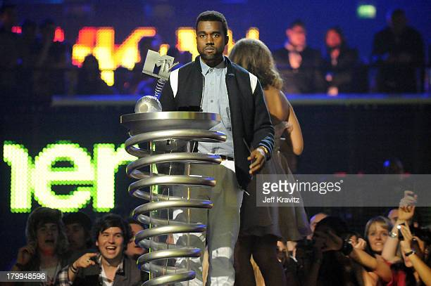 Kanye West receives the Ultimate Urban Award from Leona Lewis at the 2008 MTV Europe Music Awards held at at the Echo Arena on November 6 2008 in...