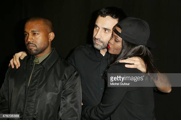 Kanye West Ricardo Tisci and Rihanna pose after the Givenchy show as part of the Paris Fashion Week Womenswear Fall/Winter 20142015 on March 2 2014...