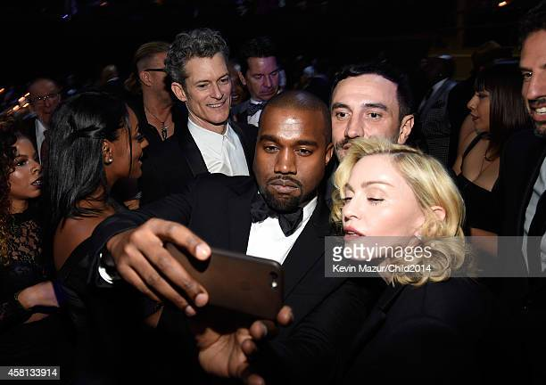 Kanye West Riccardo Tisci and Madonna attend Keep A Child Alive's 11th Annual Black Ball at Hammerstein Ballroom on October 30 2014 in New York City