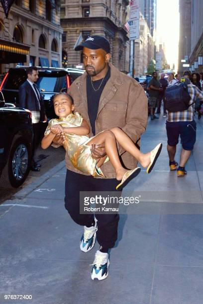 Kanye West seen carries daughter North West as they leave the Polo Bar Restaurant in Manhattan on June 15 2018 in New York City