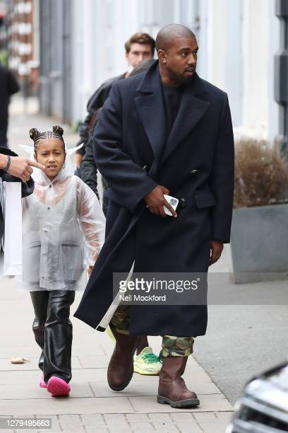 Kanye West seen leaving Michiko Sushino restaurant with his daughter North West in Queen's Park on October 10 2020 in London England