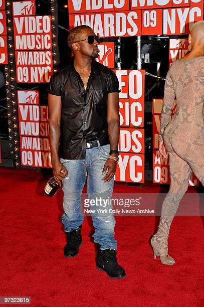 Kanye West slugging a bottle of Cognac and Amber at the MTV Music Awards held at radio City Music Hall