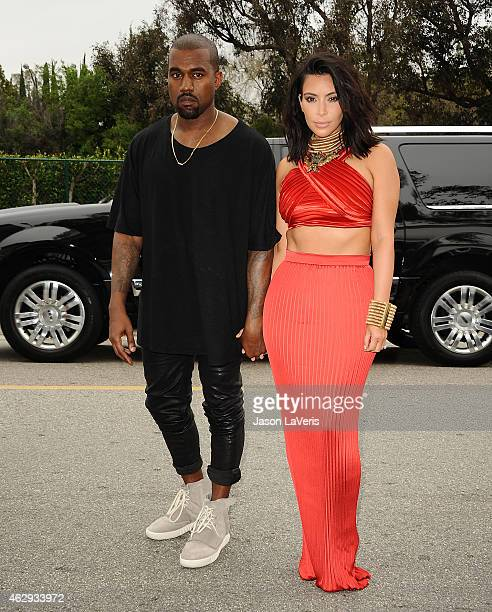 Kanye West speculated to be wearing the Yeezy 3 sneakers Yeezy 750 Boost and Kim Kardashian attend the Roc Nation Grammy brunch on February 7 2015 in...