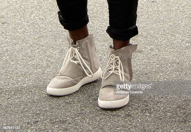 Kanye West speculated to be wearing the Yeezy 3 sneakers 'Yeezy 750 Boost' arrives at the Roc Nation Grammy Brunch 2015 on February 7 2015 in Beverly...
