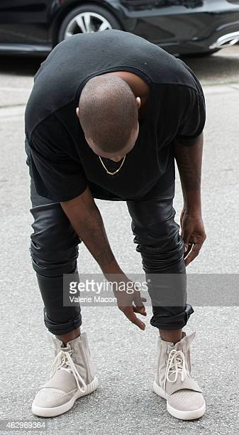 Kanye West speculated to be wearing the Yeezy 3 sneakers 'Yeezy 750 Boost' arrives at the Roc Nation PreGRAMMY Brunch on February 7 2015 in Beverly...
