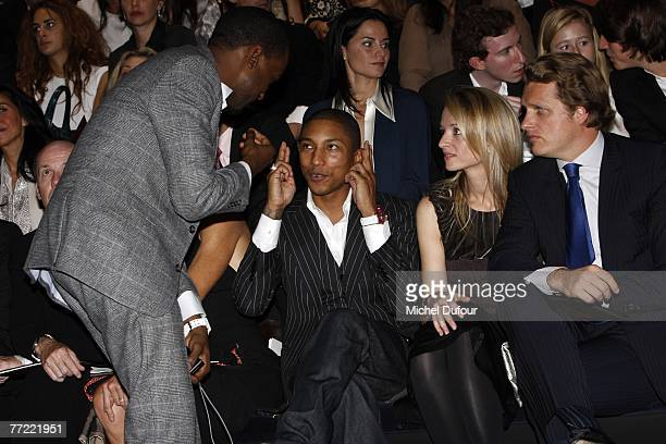 Kanye West William Farrel Delphine Arnault and Alessandro Vallarino Gancia attend the Louis Vuitton fashion show during the Spring/Summer 2008...