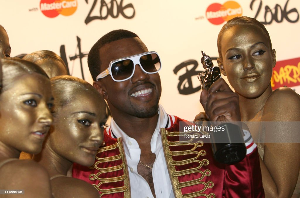 Kanye West with his Brit Award for Best International Male Solo Artist