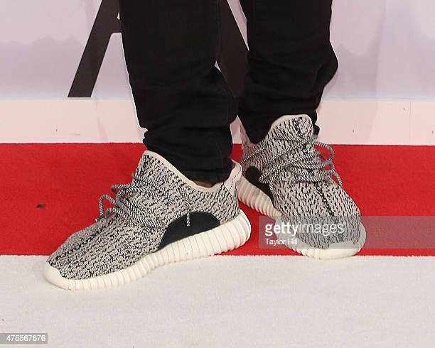 Kanye West Yeezy Adidas shoe detail attends the 2015 CFDA Awards at Alice Tully Hall at Lincoln Center on June 1 2015 in New York City