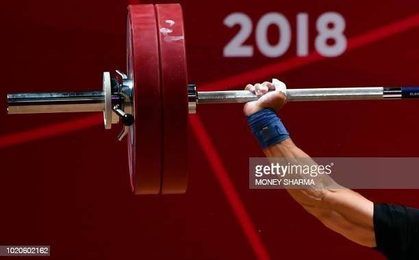 Kao Chanhung of Taiwan competes in the men's 62kg weightlifting event during the 2018 Asian Games in Jakarta on August 21 2018