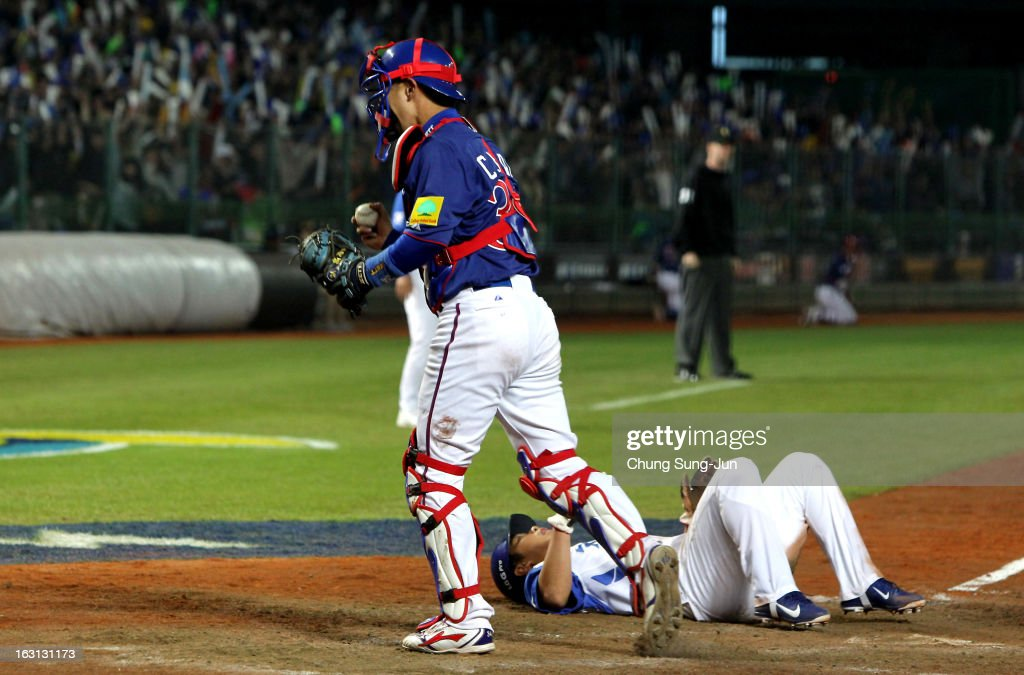 Kao Chih-Kang of Chinese Taipei tags out Jeong Keun-Woo of South Korea as he slides into home in the fifth inning during the World Baseball Classic First Round Group B match between Chinese Taipei and South Korea at Intercontinental Baseball Stadium on March 5, 2013 in Taichung, Taiwan.
