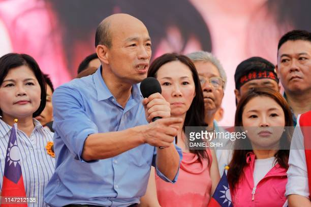 Kaohsiung city mayor Han Kuoyu from the Kuomintang party gestures while speaking to his supporters during a campaign event in Taipei on June 1 2019